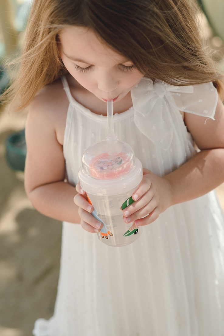 nuSpin Kids Sip & Spin straw cup, the pinwheel spins when you drink.